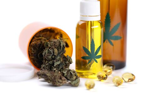 Legal cannabis grass with cbd oil isolated on white background. Marijuana herbal cancer treatment concept Banco de Imagens