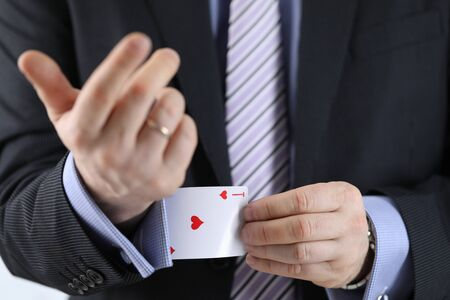Close-up of business leader having ace card in sleeve. Metaphor to confidence in winning. Businessman ready for risk and development. Self-assurance concept Stockfoto
