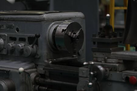 Focus on nested workshop utility in modern factory used for cutting steel rods and making new automobile details out of different types of metal. Manual manufacturing process concept Banco de Imagens