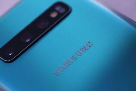 Minsk, Belarus - March 8, 2019 : Smartphone samsung galaxy s 10 aquamarine color Illustrative editorial