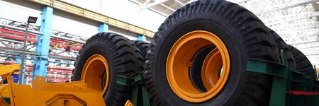 Set of extremely big wheels standing at warehouse of machine building plant