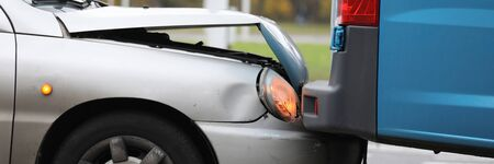 Focus on damaged bumper of vehicle in car accident in city. Damaged parts of transport. Automobile with breakdown and crashed details. Collision of auto on road
