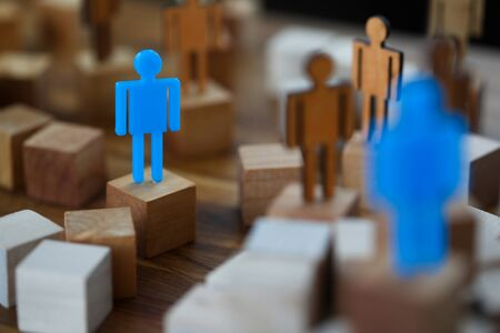 Lonely blue toy man figurine met soul mate closeup background. Global communications concept
