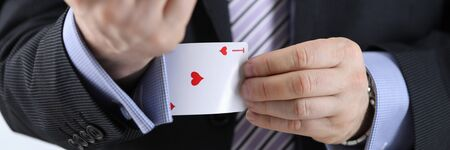 Close-up of business leader having ace card in sleeve. Metaphor to confidence in winning. Businessman ready for risk and development. Self-assurance concept