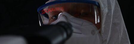 Male in protective suit biochemist monitoring chinese coronavirus portrait. Treatment of pulmonary pneumonia in hospital concept
