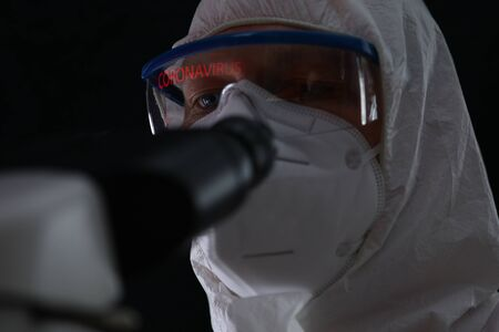 Male in protective suit biochemist monitoring chinese coronavirus portrait. Treatment of pulmonary pneumonia in hospital concept