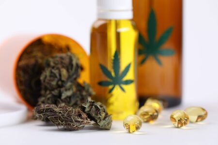 On table marijuana in jar and hemp oil in capsules. Help for cancer patients. Medical cannabis reduces frequency and duration epileptic seizures. Made from hemp natural preparations Stock fotó