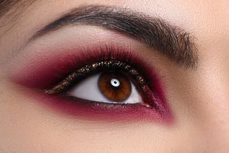 Close-up beautiful female eye decorated with makeup. Quarantine makeup training. Make-up option that is created for special occasion. Fashionable eye for events or for photo shoots Stock fotó