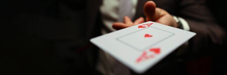 strategy business card game. Gambling cards, man suit throws card to floor. Man in suit throws card. Gambling creates annoyance and frustration. Player throws game.