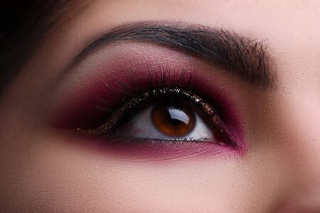 Close up, beautifully painted eye in oriental style. Correction eyebrow tattoo. Makeup training online. Beautiful female eye decorated with makeup. Fashionable eye for events or for photo shoots Stock fotó