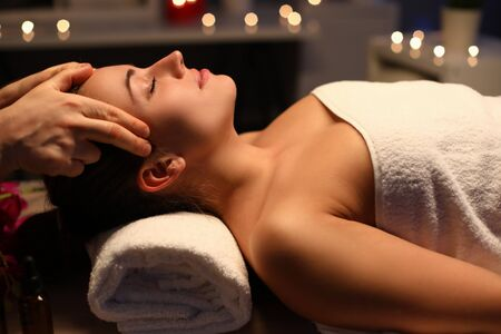 Girl doing relaxation head massage in beauty salon. Unforgettable sensations lightness and vivacity. Deep relaxation technique. Fingers massage head to beautiful girl. Pleasant sensations