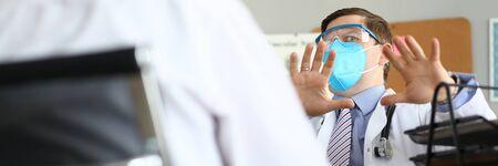 Male doctor fears patient thinks he has a dangerous virus portrait Reklamní fotografie