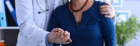 Male doctor hugged elderly lady helping to go out. Social isolation elderly. Multiplicity disorders complicates diagnosis and appointment adequate treatment. Understanding his mental state