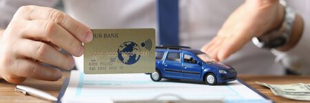 Agent offers to buy car credit card and clearance. Purchase and registration vehicle. Execution documents confirming ownership rights. Acceptance transfer deed supported by dealers signature