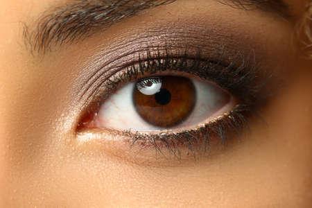 Close up of beautiful female eye with long eyelashes
