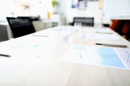Desk in office with meeting documents. Venue for business events concept