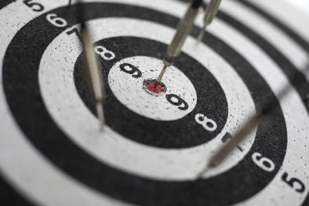 Darts game with darts. Accuracy and motivation to achieve the goal Archivio Fotografico