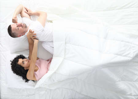 Man and woman swear in bed. Family psychology concept Stock Photo