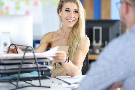 Beauty blond businesswoman portrait against modern office portrait. Business education concept Foto de archivo