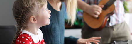 Parents teach daughter to play musical instruments. Develop logical thinking and creativity. Development musical art, genres. Long-term hard work. Parents monitor quality classes