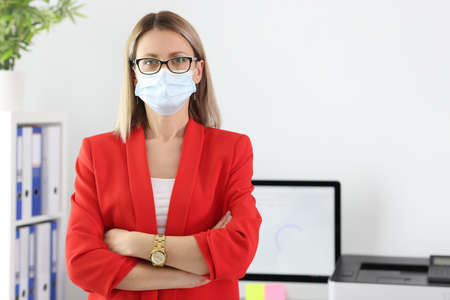 Portrait of businesswoman in medical protective mask and and suit in office. The new reality of covid-19 prevention concept