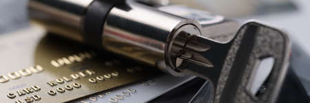 Plastic bank cards with lock with key. Security of banking system and money transfers concept Banque d'images