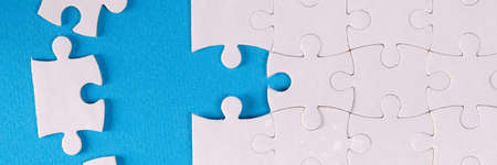 Folded white jigsaw puzzles blue background business Challenges and solutions concept