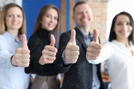 Group of business people showing thumbs up closeup Stock Photo