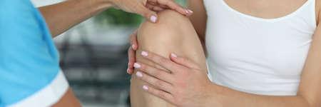 Doctor examines patient's leg in the office. Knee injury concept Standard-Bild