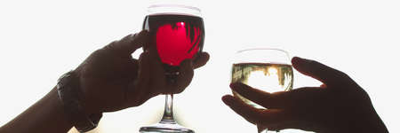 Men and women are holding glasses of red and white wine Stock Photo