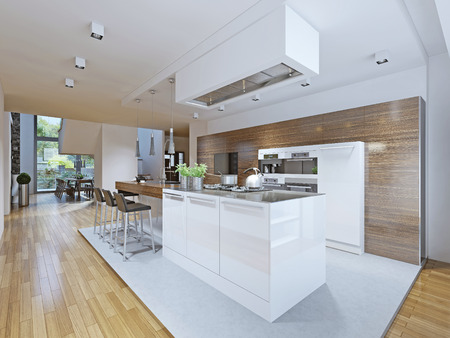 kitchen cabinets: Bright kitchen avant-garde style. Kitchen cabinets and countertop bar with dark wood texture and kitchen appliances made in white. From this angle you can see the dining room and the stairs to the second floor. The kitchen is separated from the rest by me Stock Photo