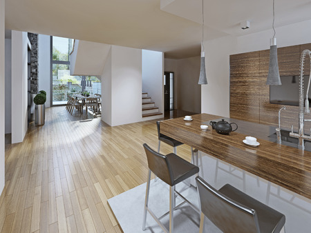 white kitchen: High-tech styled kitchen with dining room. The bar counter with stools black. Kitchen furniture is made in the texture of striped dark wood. Two-storey panoramic window perfectly illuminate the entire room. The kitchen is located on a hill made of polishe Stock Photo