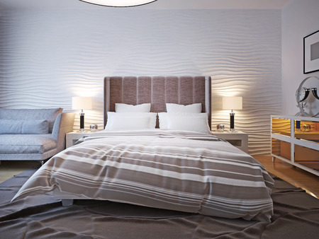 bedside lamps: Unmade bed with large headboard. Two bedside table with lamps on both sides of the bed with a large headboard. The wavy wall behind and a big ceiling lamp. 3D render Stock Photo
