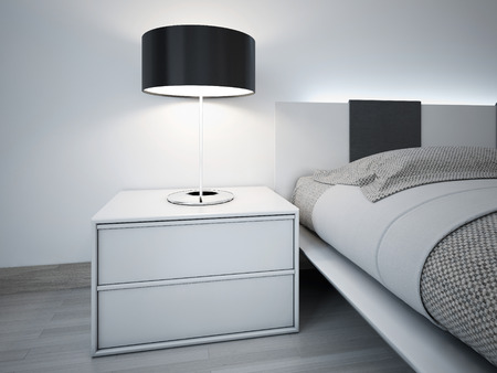 bed: Contemporary monochrome bedroom design. Stylish bedside table near bed with neon lights behihd headboard. Lamp with black lampshade. Stock Photo