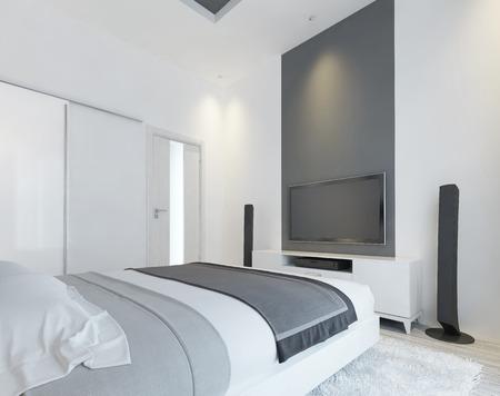 #60562507   TV Konsole Mit Lautsprechern In Der Modernen Schlafzimmer In  Weiß Und Grau. Moderne Schlafzimmer Mit Begehbarem Kleiderschrank  Schiebetüren Und ...