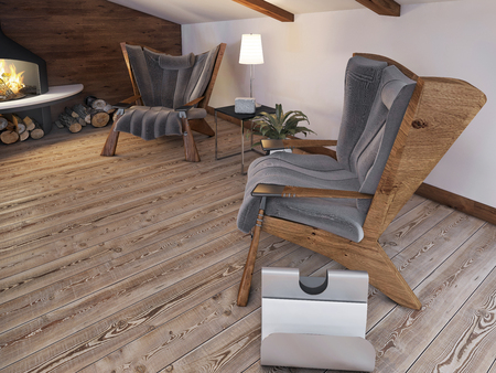 seating area: Comfortable seating area of the two chairs by the fireplace in the attic in the loft style. 3D render. Stock Photo