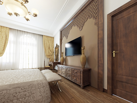 A TV set on the wall and a TV stand with wooden carvings of a Middle Eastern Arabic style. 3D rendering.