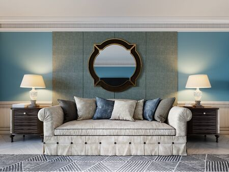 Front view of a luxurious beige sofa in a classic style with two wooden bedside tables with lamps and a mirror on a light blue wall background. 3D rendering. 免版税图像
