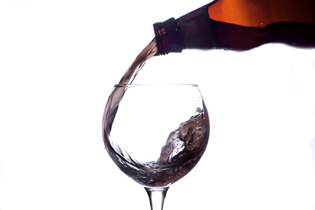 the liquid is poured into a glass and spray Reklamní fotografie