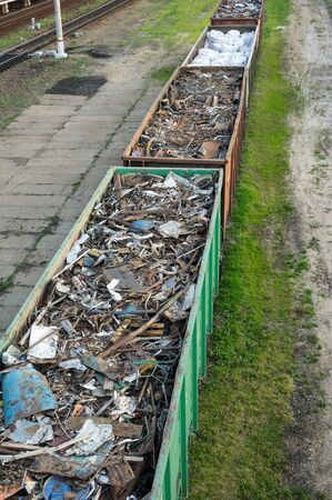 Railway wagons filled with scrap metal for metal recycling