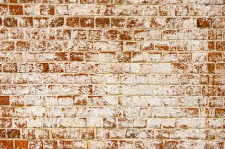 Grunge red brick wall with disappearing paint texture or background