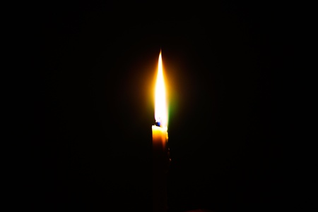 Flame of a candle Stock Photo