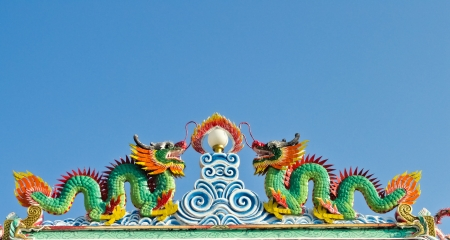 Twin dragon statues in Chinese style on top of general temple roof  Stock Photo - 11228852