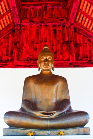 Copper buddha statue photo