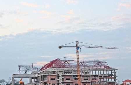 Buildings under construction and cranes under a blue sky  Stock Photo - 12432795
