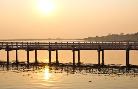 Wooden bridge in the marsh at sunset