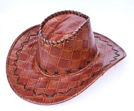 Brown leather hat isolated on white  Traditional hat for all american cowboys  photo