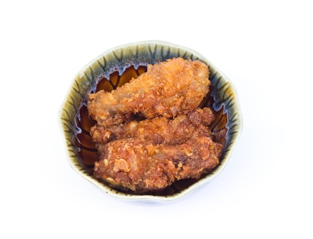 Fried chicken in a ceramic cup on whiteground photo