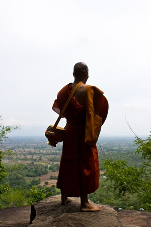 Buddhist monks on a cliff Stock Photo - 13533102