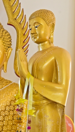 Golden Buddha statue in the ancient church photo